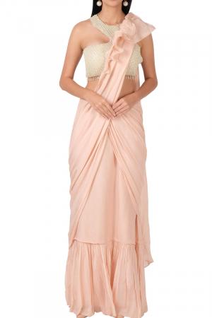 Pearl blouse with blush ruffle saree