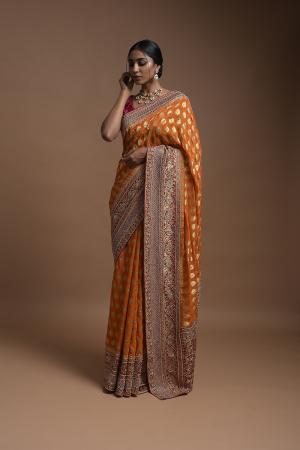 Pumpkin Orange Banarsi Saree In Georgette With Weaved Floral Mesh And Floral Jaal On The Red Pallu