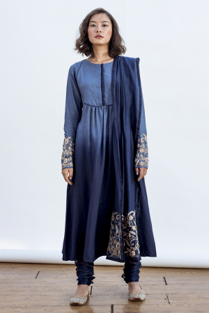 Susan kurta with a round yoke and emrboidery on sleeves and dupatta. features a churidaar  style pant.