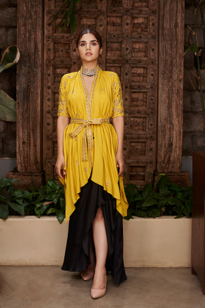 Black draped skirt with Mustard wrap jacket and ebroidered belt