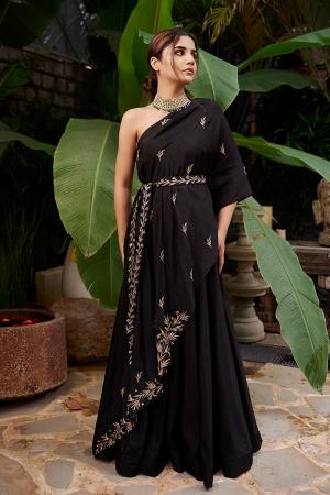 Black one shoulder cape with Black embroidered belt and Black skirt
