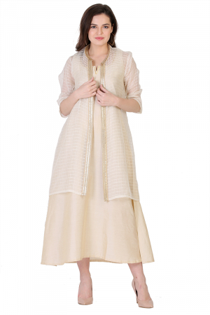 beige kaftan with a see though jacket