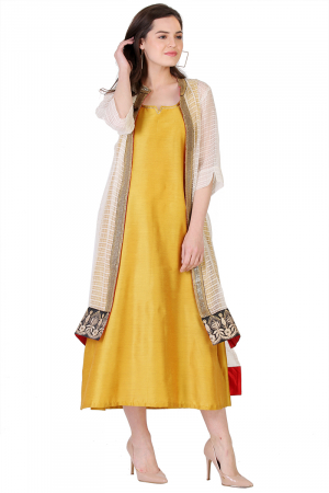 mustard yellow kaftan with a see though jacket