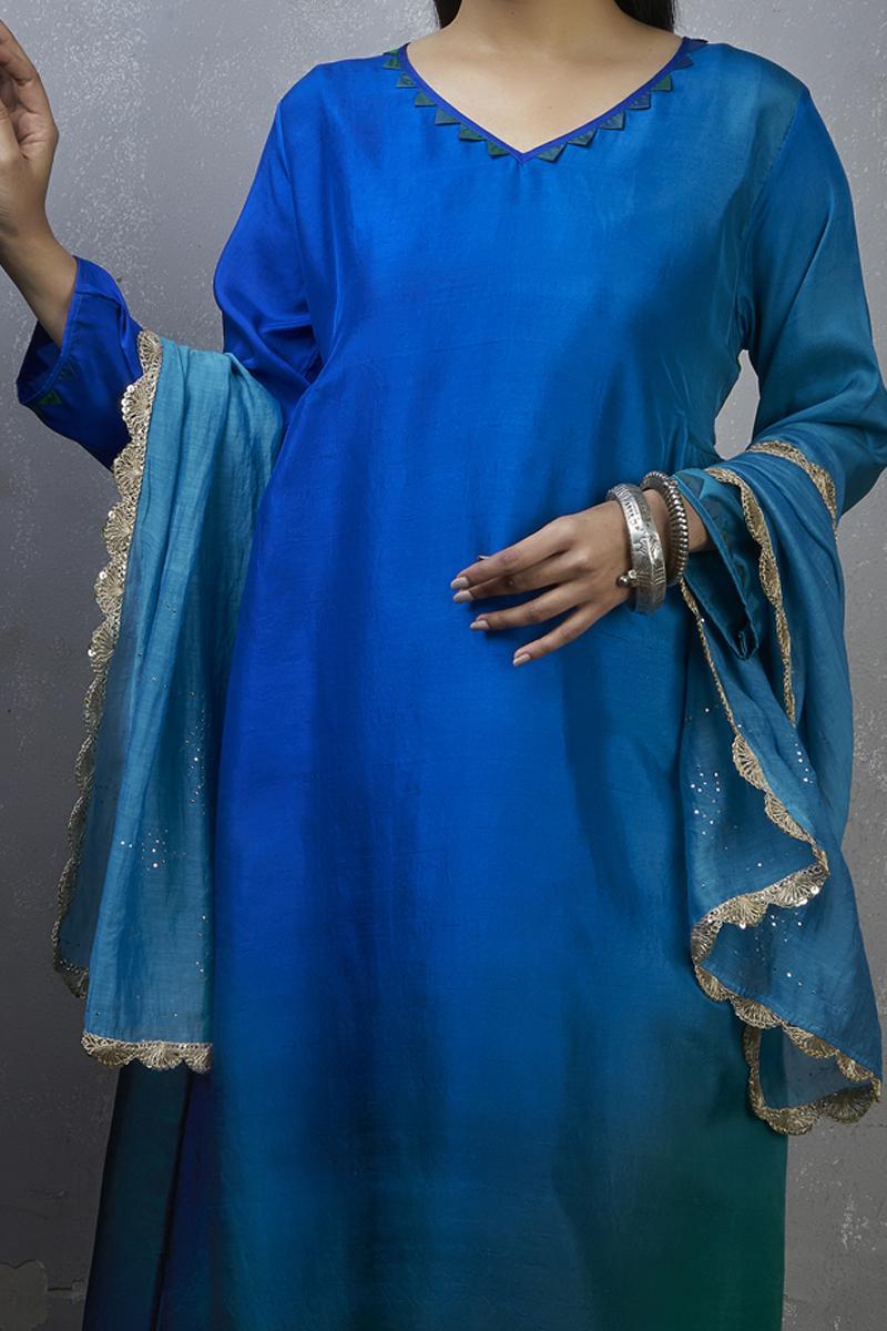 Green blue Ombre hued Asymmetric kurta with pants and dupatta.